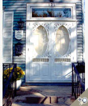 Southern Grace double door painted white. Shown withe tempeed storm insert. Browse more Victorian deisgns that can be made into double doors.